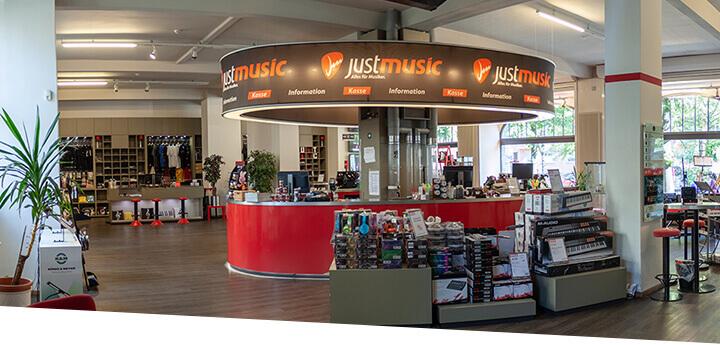 JustMusic Berlin FlagShipStore - Erdgeschoss - Kassen und Merch